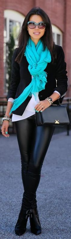 Black skinny jeans, black jacket, white shirt and teal scarf