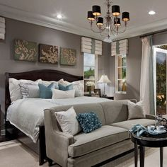 Master suite with warm greys and neutrals. I love the idea of a couch at the end of the bed!