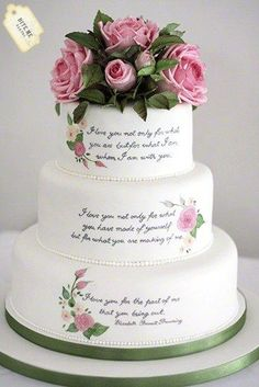 "Literary themed wedding cake with sugar roses and foliage and handpainted quote by Elizabeth Barrett Browning which reads ""I love you not only for what you are, but for what I am when I am with you. I love you not only for what you have made of..."