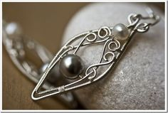 silver and pearl leaf shaped wire wrapped earrings