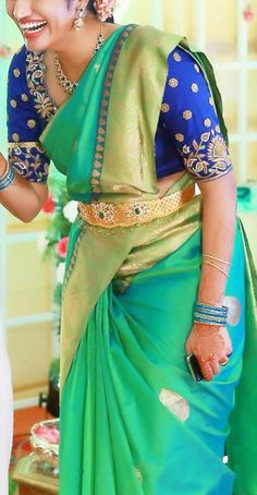 South Indian bride. Temple jewelry. Jhumkis.Blue green silk kanchipuram sarees with contrast navy blue blouse.Braid with fresh flowers.Tamil bride. Telugu bride. Kannada bride. Hindu bride. Malayalee bride.Kerala bride.South Indian wedding.