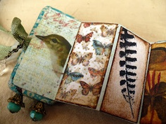 livewire jewelry inside pages of altered domino book