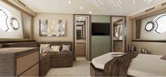 """The master cabin of the MCY 70 has an """"L"""" shaped sofa to starboard, a walk in closet aft to port and a large, beautifully designed head aft to starboard."""