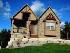 Branson Canyon ''Osage'' floor plan has one main level and a basement with five bedrooms and four baths. Home will feature cathedral ceilings, stone fireplace in the great room, and large recreational room in the basement.#thecrispinteam