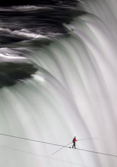 Nik Wallenda walk across Niagara Falls. from Living on the edge: 30 extreme photos that will take your breath away