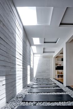 Natural lighting for a basement areas , Courtyard House by Buensalido Architects