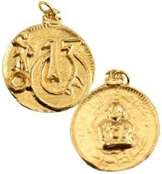 """Change Your Luck amulet. Showing the image of Buddha with a luck moon on one side, and balanced on the other with several more symbols of good fortune. Made in USA. Has cord. Pewter. 1 1/4"""""""