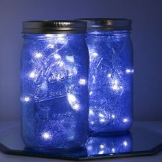 Make these easy DIY Galaxy Mason Jars to light up the night inside or out! Diy Galaxy Jar, Galaxy Crafts, Mason Jar Crafts, Mason Jar Diy, Homecoming Decorations, Galaxy Lights, Galaxy Wedding, Galaxy Theme, Blue Mason Jars