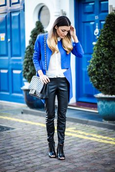 Anisa Sojka wearing royal blue Finders Keepers blazer from Fashion Bunker, white H&M buttoned up blouse, black Zara leather trousers, black Chanel cross-body bag with gold chain and black Missguided croc block heel boots. Fahsion blogger street style shot in London by Cristiana Malcica.