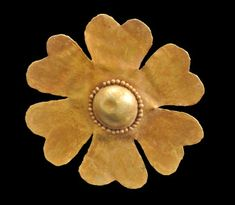 Scythian Gold Gorytos Flower  Beautiful six petal leaf shaped gorytos with a central raised semi-sphere of gold that has small beading all round.  5th to 6th Century BC