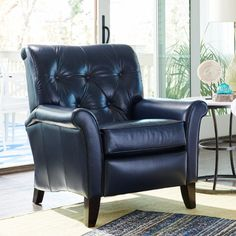 Inspired by the wingback chair, Thorne takes a traditional style and makes it its own. Sans wings. This high-leg recliner flaunts a handsome button-tufted back, simple, flared, rolled arms and tapered legs. And it gets along with all sorts of furniture groupings.