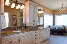 master bathroom glazed cabinetry. LOVE the cabinets and light fixtures.