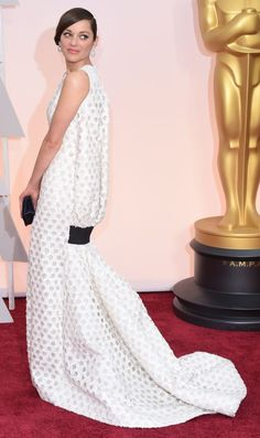 Click for more white dresses from the Oscars 2015 red carpet! Marian Cotillard in Christian Dior Couture. Love that back. http://theknot.ninemsn.com.au/inspiration/bride-dress-party/wedding-dress-bride-dress-party/oscars-2015-red-carpet-white-dresses-we-love