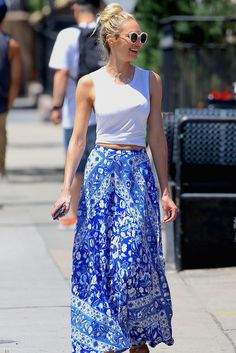 Candice Swanepoel wearing Spell & the Gypsy Collective Lolita Split Skirt in Bluebell, Illesteva Palm Beach Sunglasses in Cream Marble and Mara & Mine X Candice Swanepoel Harper Sandals in Tan