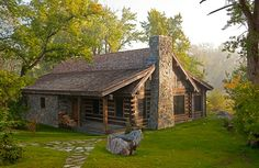 Rock and Log vacation home along a river.  RMR Group