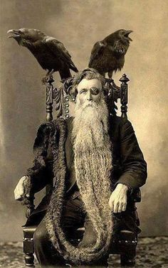 Hans Langseth, who held the record for the longest beard with 5,33 meters. Note the wonderful and totally subtle hints to Odin - the missing eye, the ravens Huginn and Muninn and the patterns on the throne Hlidskjalf. And by the way, this is not the original picture - this is shopped; no eyepatch or ravens ins the original.