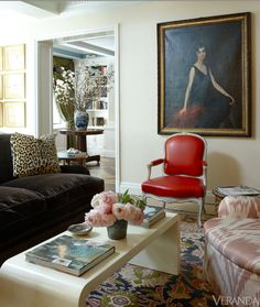 Traditional art, leopard pillows and mod coffee table
