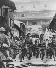 Japanese army soldiers entering the port of Ningbo, south of Shanghai, 1937.