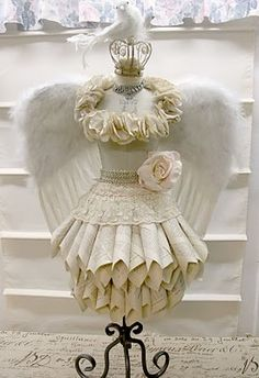 Ok, not sure, but I like it. Do you think if you were wearing this at your wedding, he'd get the message?? lol Note the crown, angle wings, bling necklace...Lovin' it!!