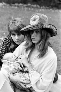 29th June 1971:  Mr and Mrs David Bowie take three-week-old Zowie for a walk pic by Ron Burton
