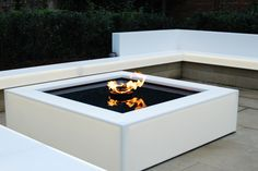 Corian® outdoor benches and water fire pit area. Made in Glacier Ice which is translucent and lit with back lighting. Fabricated by Counter Production Ltd