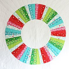 Festive Wreath by Tamara Kate.  Based on the color wheel quilt from 'Last Minute Patchwork & Quilted Gifts' by Joelle Hoverson.