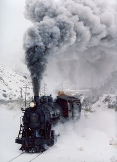 ,Cool steam engine plowing through snow in a northern state