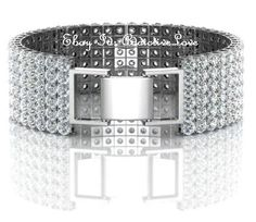 WOMEN'S 18KT WHITE GOLD DESIGNER MANMADE 27CT DIAMOND TENNIS BRACELET, $298.00 (http://diamond-rings-under--100.mybigcommerce.com/womens-18kt-white-gold-designer-manmade-27ct-diamond-tennis-bracelet/)