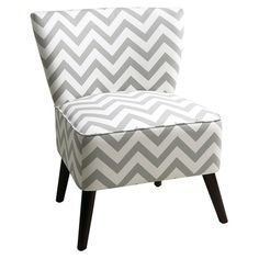 Solid wood-framed accent chair with exposed legs and grey chevron upholstery.   Product: ChairConstruction Material...