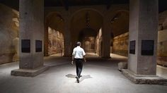 A security man walks inside a room at the House of Augustus on the Palatine hill in Rome on Sept 17, 2014. Lavishly frescoed rooms in the houses of the Roman Emperor Augustus and his wife Livia are opening for the first time to the public Thursday, after years of painstaking restoration. -- PHOTO: AFP