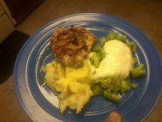 Pan fried Pork Chop with caramelized onions and apples with Mashers and Steam Broccoli with a Mornay Sauce.