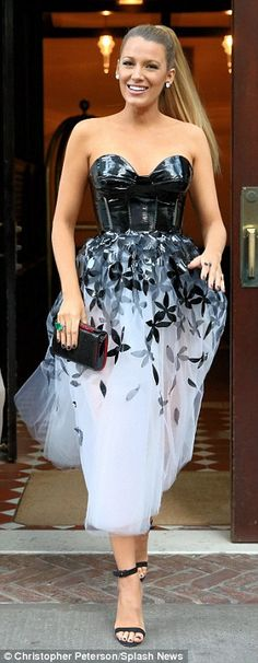Off and running: The blonde star was seen leaving her NY hotel and heading to the premiere with a smile