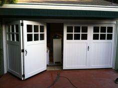 Carriage Doors. Bifold-True-carraige-garage-doors-with-accordian-hardware-Tungsten-Royce