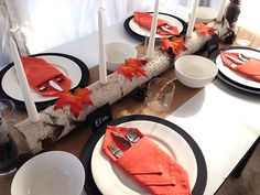 A Birch Log Used for a Centerpiece Candleholder >> http://blog.diynetwork.com/maderemade/2013/11/15/quick-and-easy-ideas-to-dress-up-your-thanksgiving-table?soc=pinterest