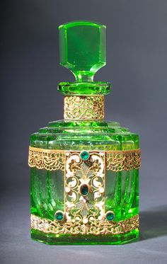 A perfume bottle, circa in green crystal, with jeweled and enameled metal. A perfume bottle, circa in green crystal, with jeweled and enameled metalwork. Made Czechoslovakia Antique Perfume Bottles, Vintage Bottles, Perfumes Vintage, Vintage Makeup, Glas Art, Beautiful Perfume, Fragrance Parfum, Bottle Art, Potion Bottle