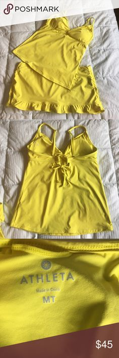 Athleta Swim Suit Tankini top is Size MT and bottoms are size L. Perfect condition I only wore this once. Athleta Swim