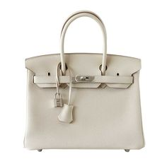 Hermes Birkin bag in size 30. Made from Togo leather and featured in the hot Craie color. Super coveted & rare! Browse Our Collection Now!