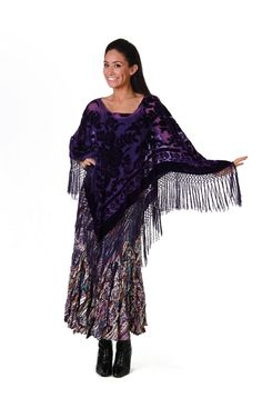 This Purple Pancho is in a burnt out velvet with rayon fringe all around it. The scoop neck is very flattering. Wear this with our purple print skit or your jeans. This is an all occasion top for all sizes. Viscose/Rayon. Dry Clean Only.One Sixe will also fit Plus Size.