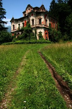 Abandoned mansion being eaten up by ivy.