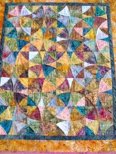 kaleidoscope quilt -  winding ways or wheel of mystery