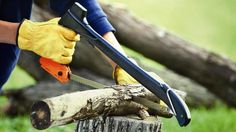 The Woodsman is a hammer, a tent stake puller, a five-inch axe, and a 15-inch wood saw