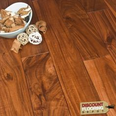 Sherwood Exotic Acacia Golden Stain is a 18mm thick solid floor acacia floor.    Each solid oak plank is constructed from one whole piece of timber which makes it an extremely authentic and natural product. This product will last for generations.  Being a natural product each board is unique in colour, mineral grain, degree of knots and sapwood. All of these natural features enhance the overall characteristics of such a beautiful oak floor.