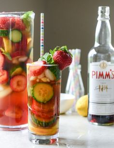 strawberry pimm's cup  ingredients: 1 handful of fresh mint 4 cucumber slices 4 strawberries, sliced 2 lemon slices 2 lime slices 4 ounces Pimm's No. 1 1 lemon wedge 1 lime wedge 4 ounces ginger beer 1 to 2 ounces club soda (you can totally leave this out if you want, I like the extra fizz minus flavor)