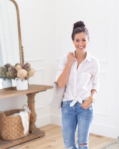 White shirt with a tie front, a bun and ripped jeans - my mom uniform!