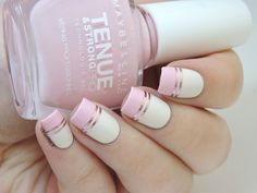 Pink graphic nails with striping tape.