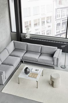 Straight, definitive lines merge with soft, large cushions in a slender sofa concept that's easy to envision anywhere. The EJ280 Elements is all about simplicity and versatility. Building on a classic frame with curved details, it's a corner sofa conceived with comfort, opening up all kinds of possibilities for placement. #fredericiafurniture #erikjørgensencollection #ej280elements #sofaseating #erikjørgensenstudio #danishdesign #lounging #modernoriginals #craftedtolast Large Cushions, Co Working, Classic Furniture, Lounge Areas, Corner Sofa, Danish Design, Sofa Design, Minimalist Design, Relax