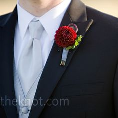 nice red dahlia boutonniere- but needs the magnet thing  to hold it the pin is…
