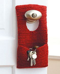 "Hang this useful organizer from a door knob to keep all kinds of small items handy. Measures approx. 5"" x 10"" (12.5 x 25.5 cm). Shown in Patons Classic Wool #207 Rich Red, using 5 mm (U.S. H or 8) crochet hook. (Patons Yarns)"