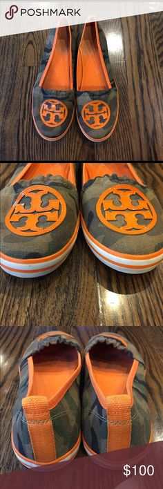 Tory Burch Camo/Orange Slip On Sneaker Adorable camo sneaker. Like new. The only signs of wear are on the foot bed inside the shoe and very slight scuffs around the sole and dirt on the bottoms. Tory Burch Shoes Sneakers