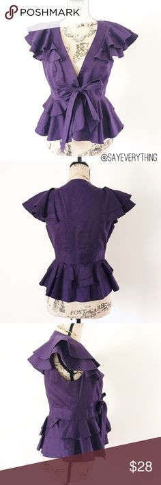 "Elevenses Purple Ruffle Tie Waist Jacket Adorable dark purple short sleeve jacket with a tie waist and flattering ruffles. By Elevenses for Anthrpologie. 100% cotton. Excellent, like new condition - no holes or stains. Size 4. Bust is approximately 17"" across and length is 23."" Adjustable depending on how tightly you tie the waist - I think a size 6 or 8 with a small bust could also fit this. So cute over a strapless dress for a summer wedding! Color is most true in last photo. Thanks for…"